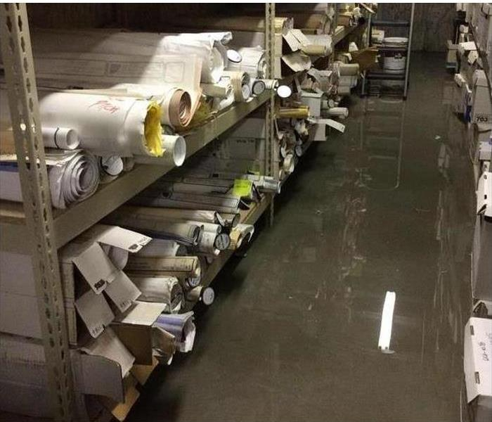 Flooded Commercial Basement Before
